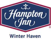 A logo for Hampton Inn Winter Haven