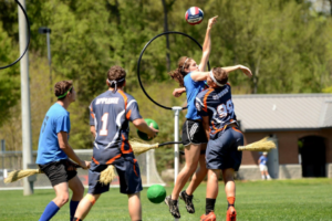Quidditch players get physical in front of the hoop.