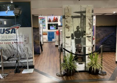 Attendees look over displays at the opening of the USA Water Ski and Wake Sports Foundation Hall of Fame Museum