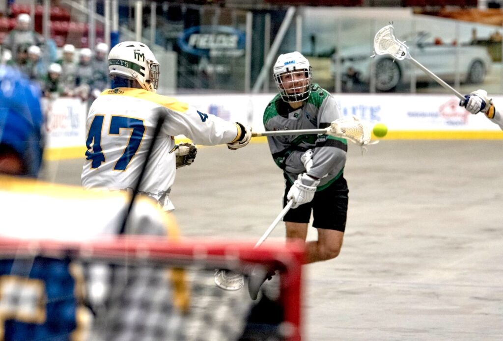 A man throws a ball at the goal during the Interstate Box Lacrosse Association National Championships at the RP Funding Center in Lakeland