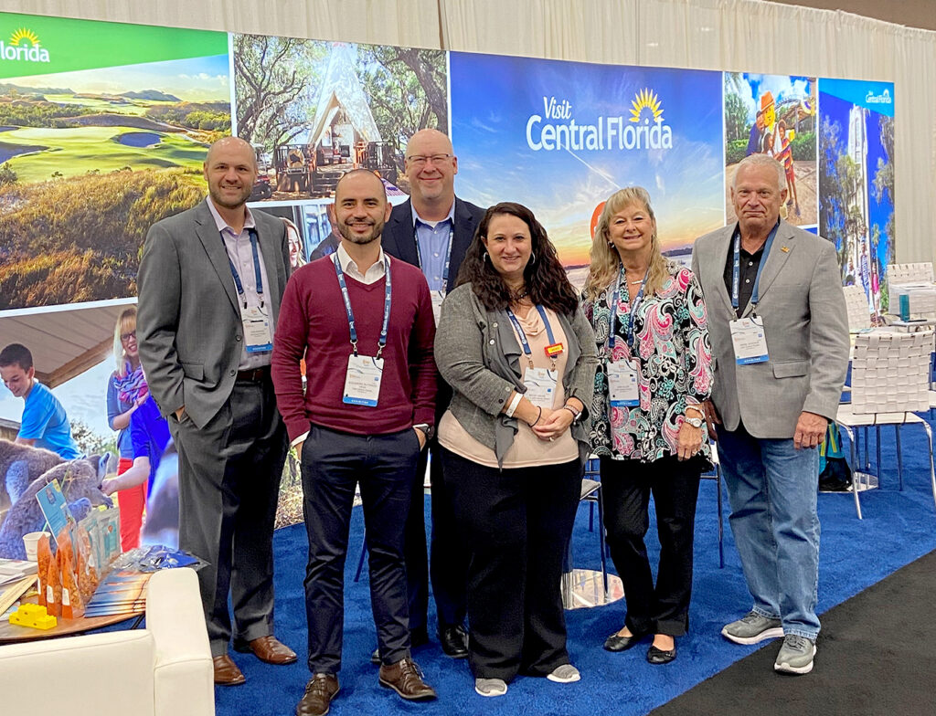 PCTSM representatives stand for a group photo at IPW. Pictured are, back row, Kris Keprios and Al Snow, front row, Alejandro Buitrago, TM Latin America; Becky Helms, LEGOLAND Florida; Joni Allen and Mark Jackson.