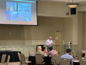 Kris Keprios of Visit Central Florida presents information during the Vacation Rental Home Summit