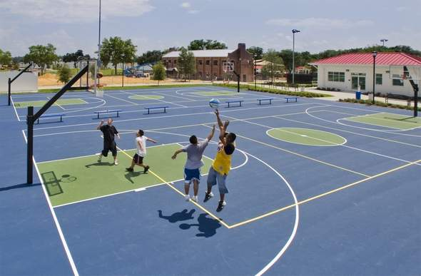 A player takes his shot on the basketball courts at Lake Eva Park