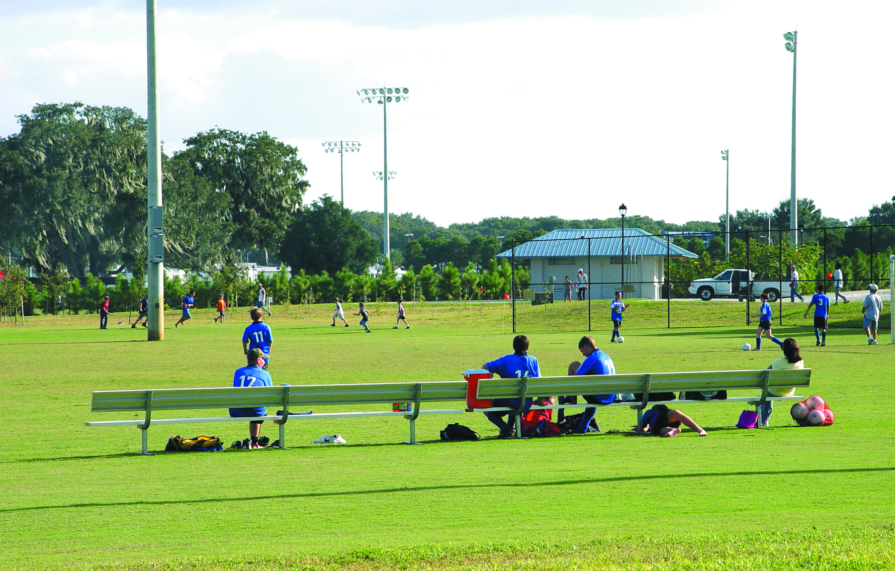 Soccer players watch the game at Lake Bonny Park