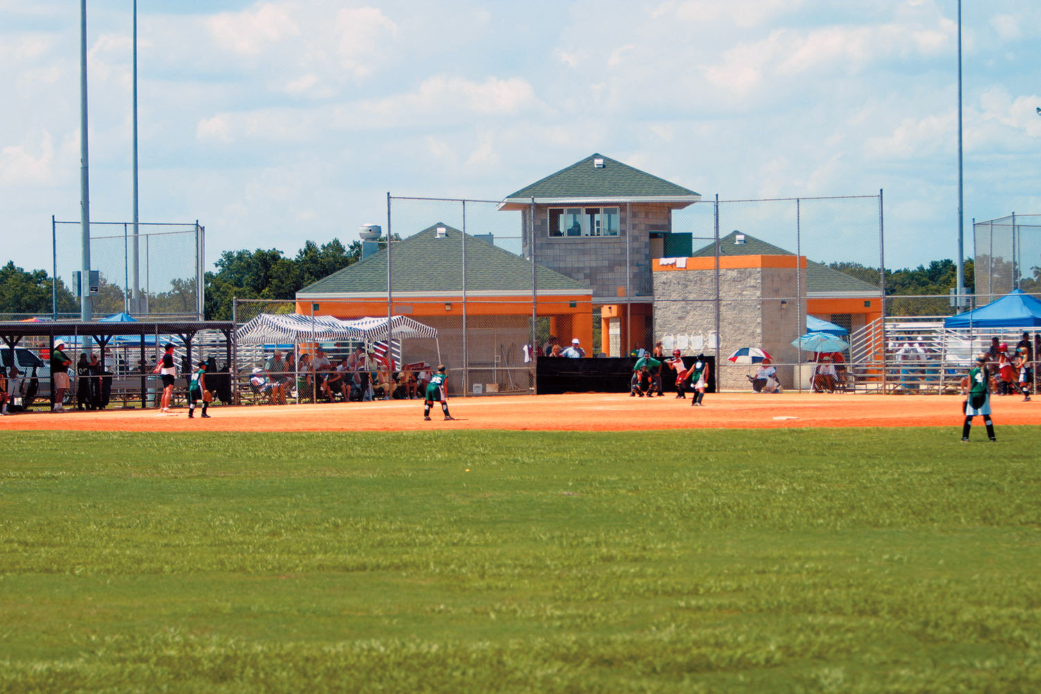 A girls softball game played at Loyce Harpe Park
