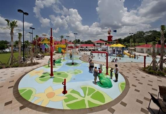 Children play at the water park at Lake Eva Park