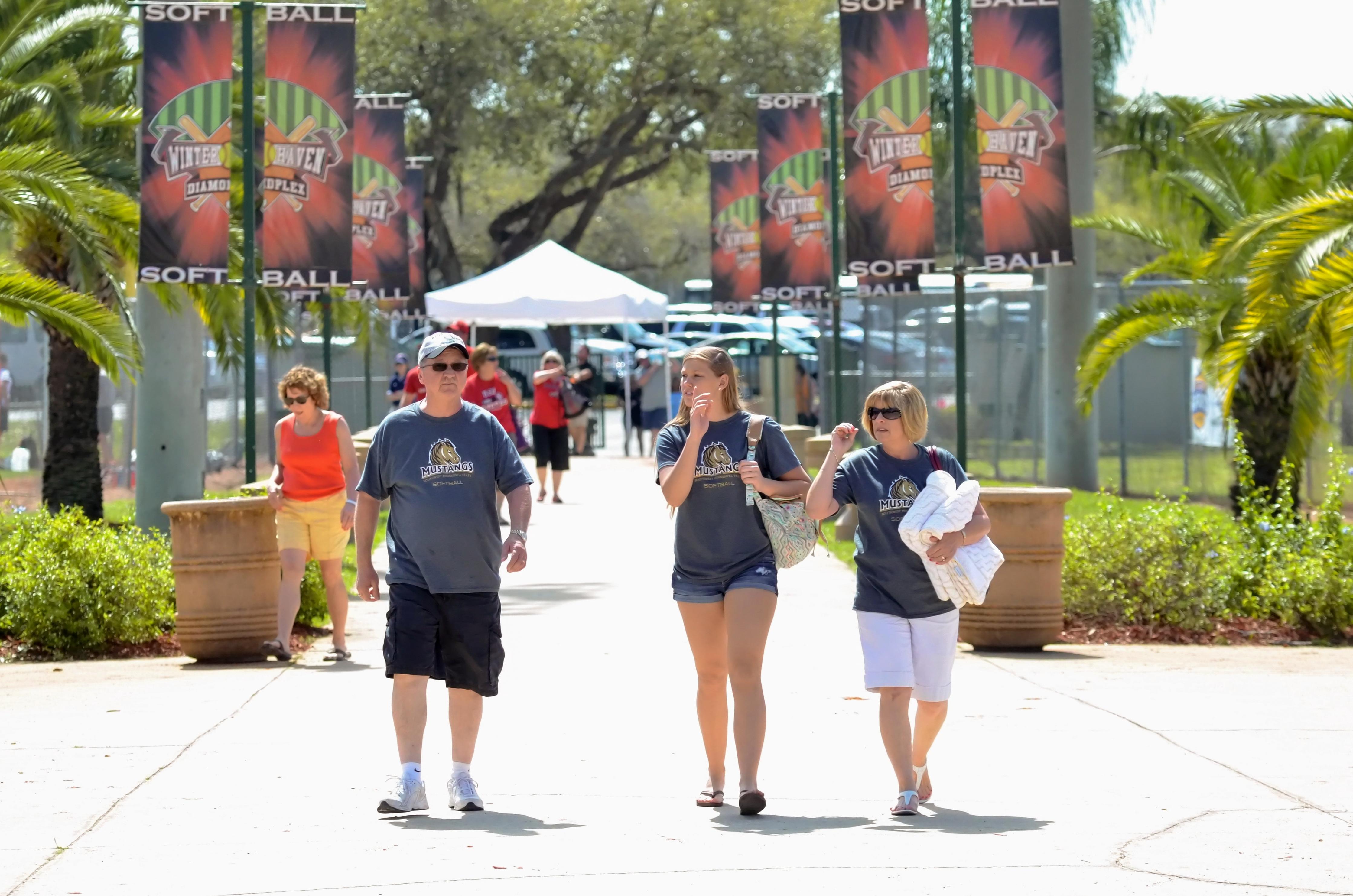 Fans walk through the stadium at Winter Haven's Diamond Plex