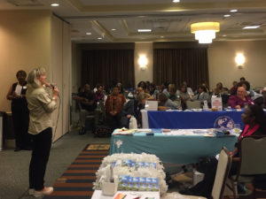 Joni Allen speaks to travel agents during an event
