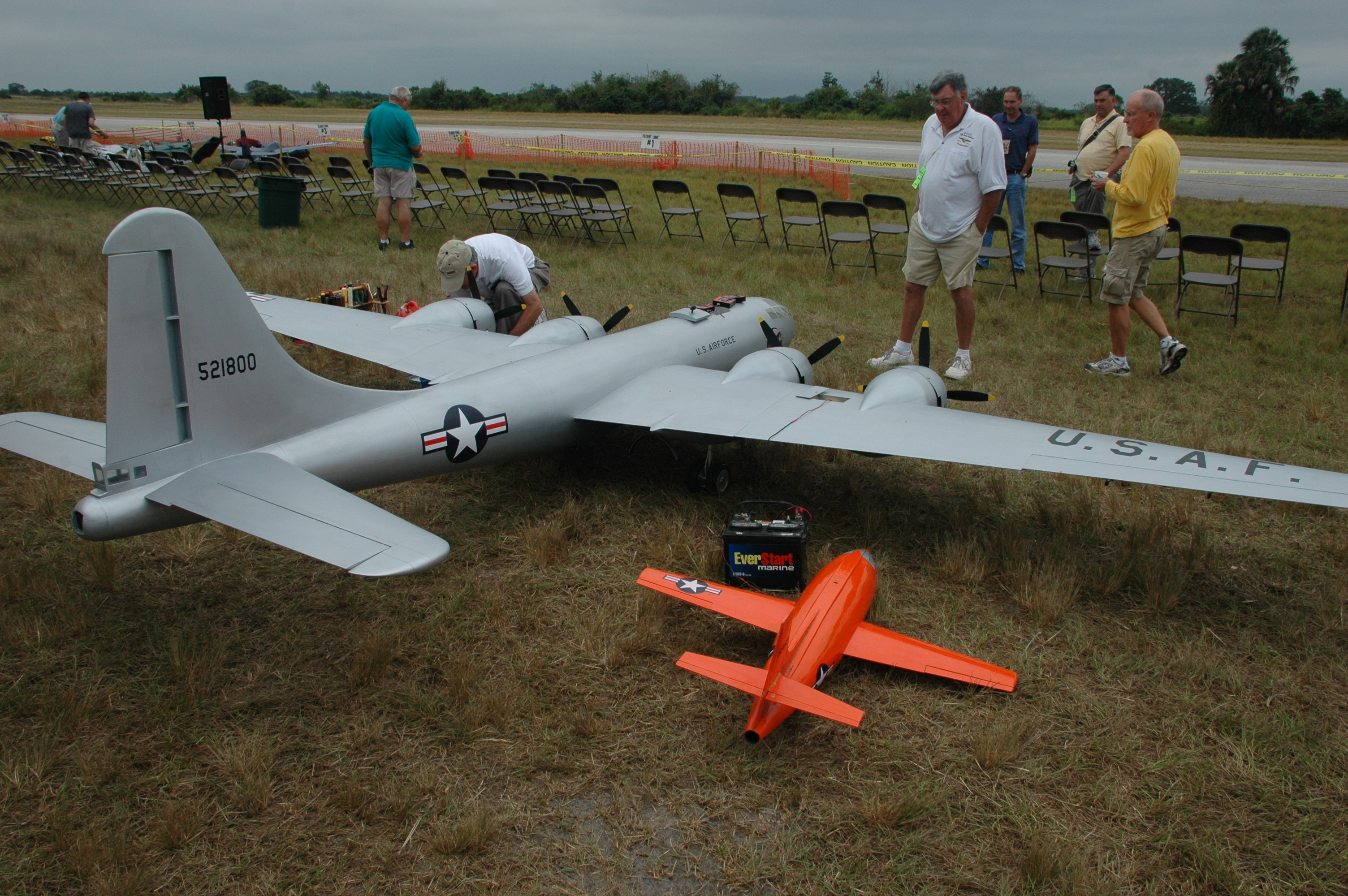 Admirers look at the large radio controlled planes on display at the Top Gun event