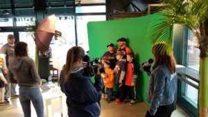 Fans stand in front of a green screen during TigerFest 2018