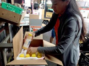 Savannah Reynoso packs bottles of orange juice at Ridge Island Groves.
