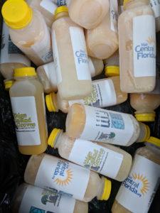 Frozen orange juice bottles with Visit Central Florida labels