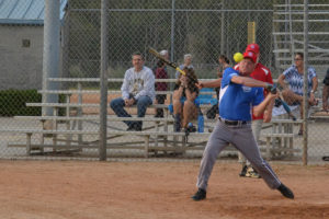 Older adult swings at softball