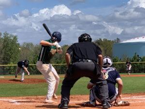A pitcher throws to a batter during RussMatt