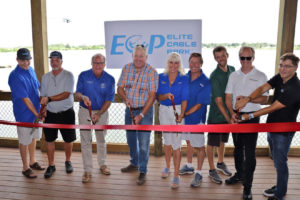 A picture of the ribbon cutting at the Elite Cable Park in Auburndale