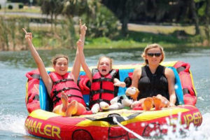Girls tube during an adaptive water ski event on Lake Silver in Winter Haven.