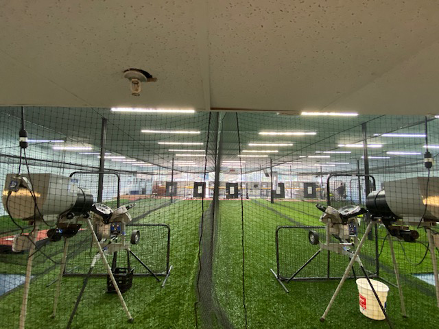 A view from behind the pitching machines at Going 406, a baseball and softball training facility in Lakeland.