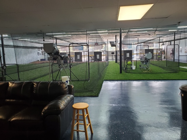 The parents area inside Going 406, a baseball and softball training facility in Lakeland, features a couch.