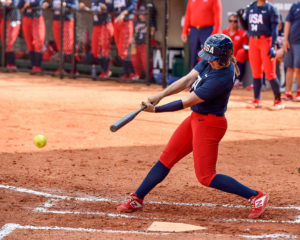 A member of the United States Softball Womens National Team swings the bat during a game