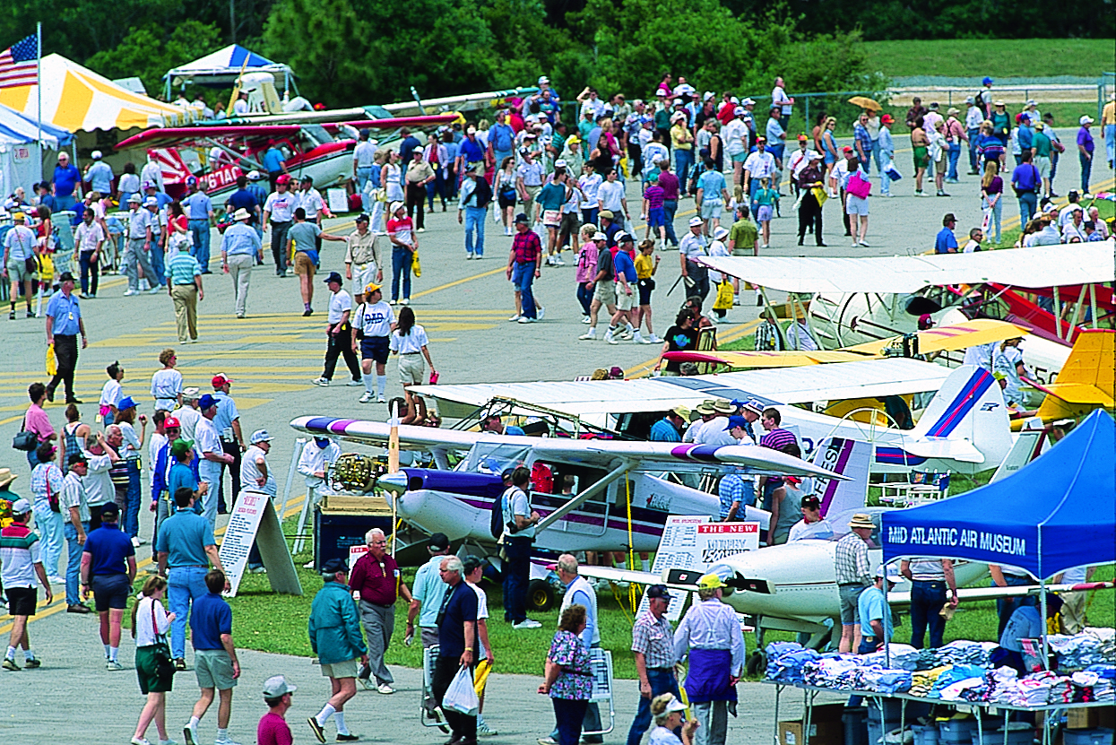 A crowd mills around planes during the Sun N Fun Aviation Expo